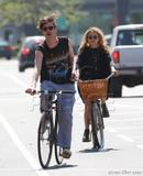 mary-kate olsen riding her bike with Nate in NY